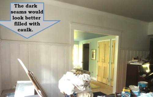 The old paneling and the new trim all need to be caulked to make the installation look seamless.