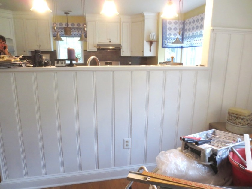 The paneling needs at least one more coat of paint all over the dining room.