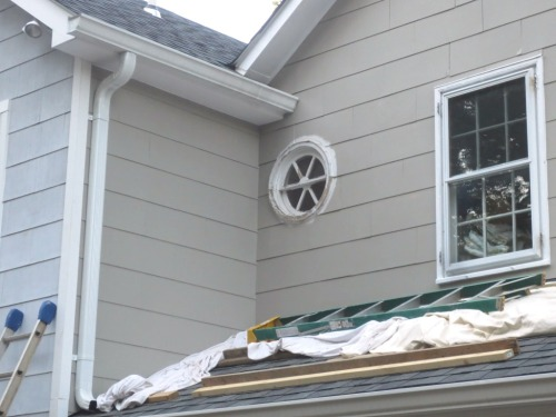 Cutting in around the round window is the only part remaining on the area above the porch.
