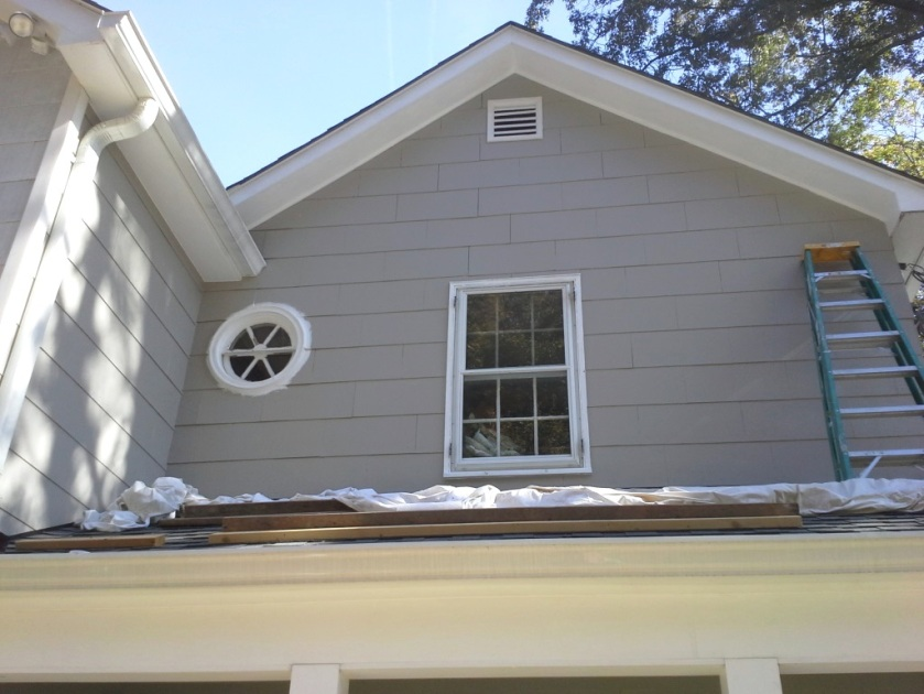 Now the eaves and area under them are completely painted.
