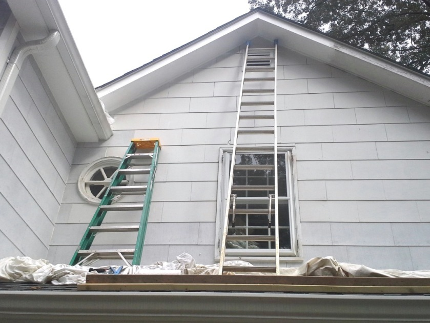 We used two by four boards as cleats to support the ladders on the porch roof.