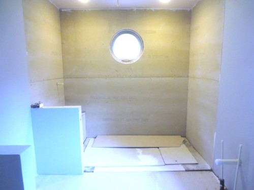 The round window in the master bathroom shower will be trimmed exactly the same as the window in the conservatory.
