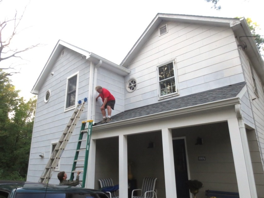 The area above the porch roof is difficult to reach.