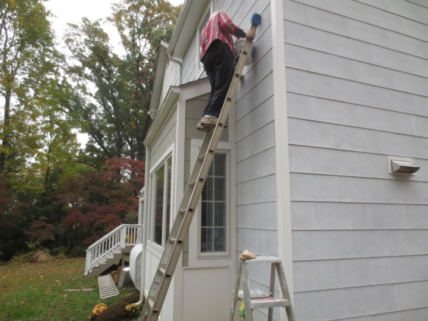 Here I am on the 12-foot ladder painting the back of the house.