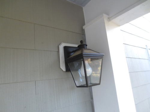 Once the house was painted grey the white area behind the front porch light looked wrong.