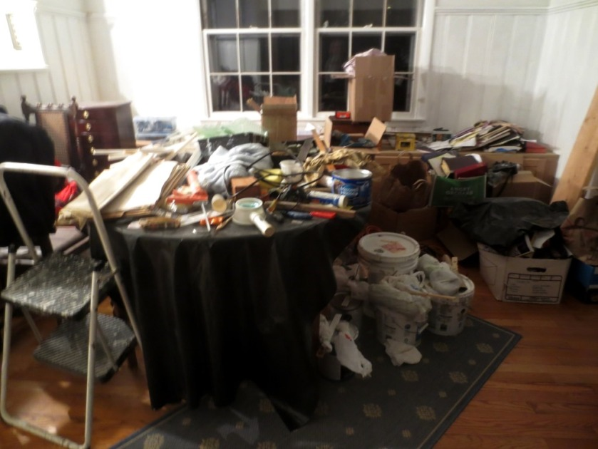 The dining room table and floor need to be decluttered.