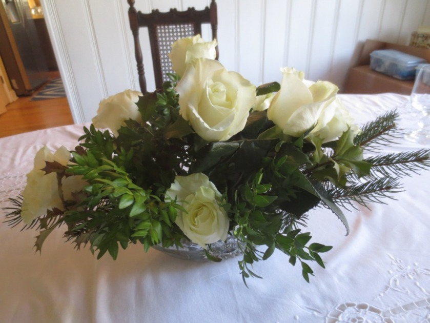 I arranged white roses with yard clippings of pine, boxwood, and holly.