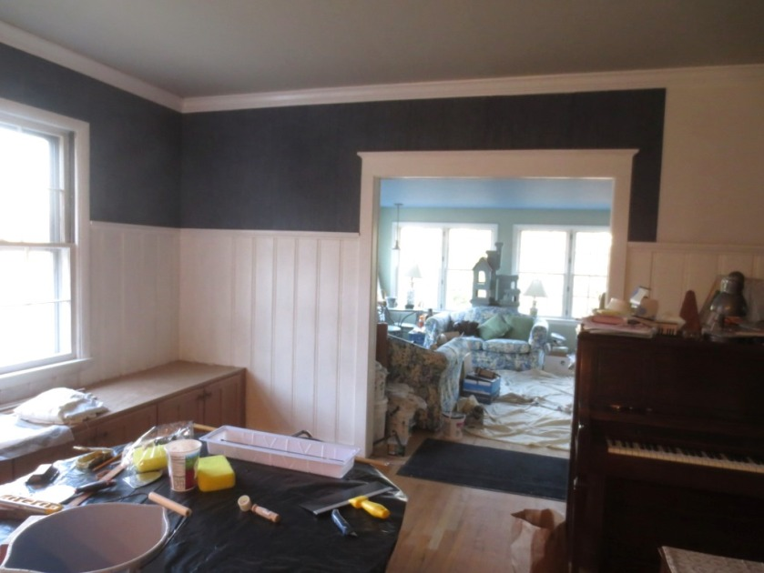 The dark blue wallpaper really accentuates the white door trim.