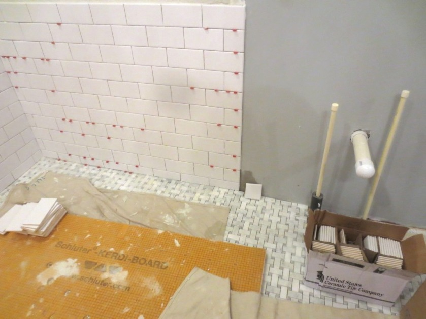 """The master bath wall tile ends with a bullnose on the 3"""" edge."""