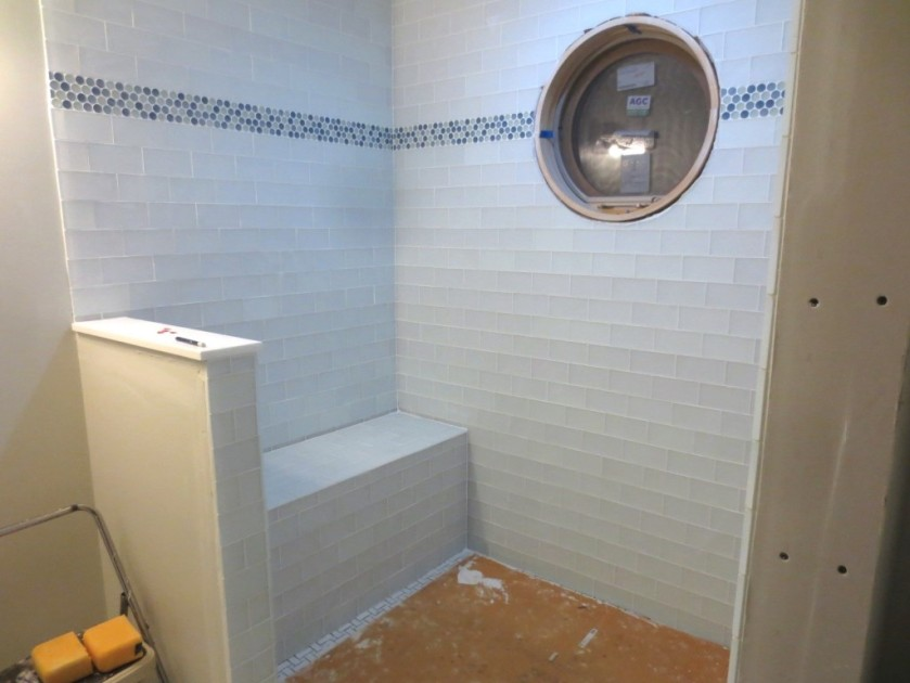 Conservatory bathroom is tiled.