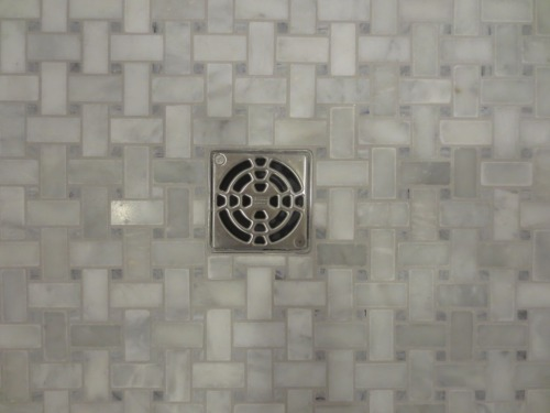 The stainless steel drain is very attractive.