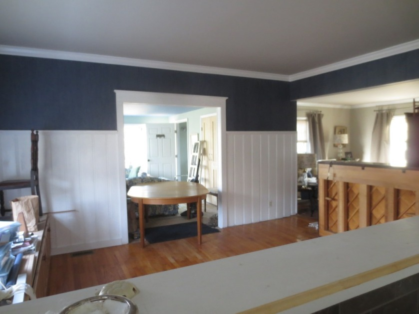 Revere Pewter ceiling, Strie blue wallpaper, Mosaic White trim and paneling, red oak flooring.