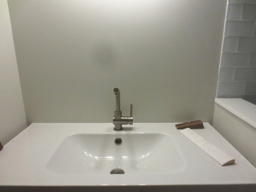 Ikea sink and faucet in the conservatory bathroom.