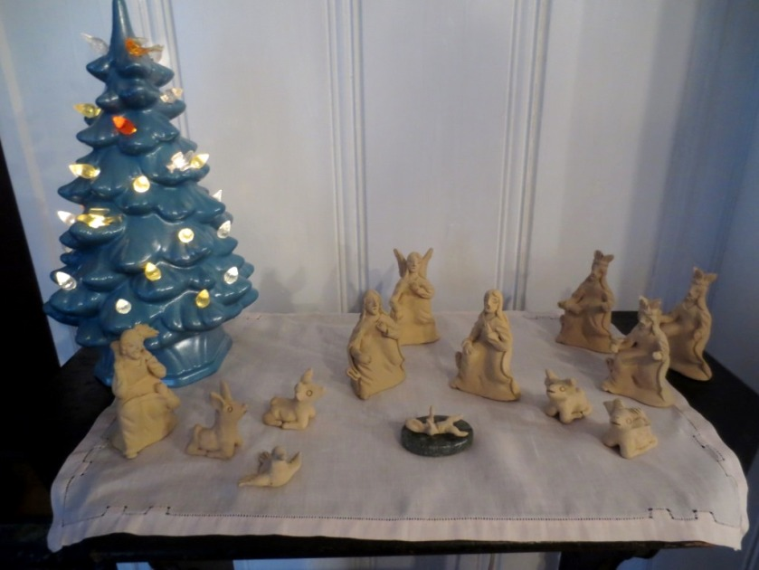 The tiny crèche at Christmas on our black stenciled magazine table.