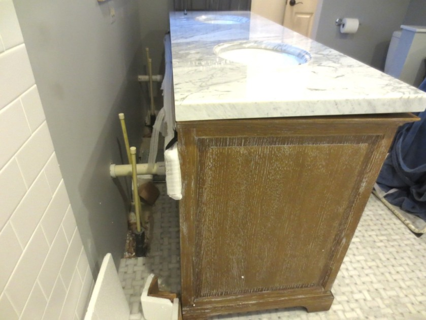 The white piece on the back just under the countertop is a long piece of wood wrapped in foam.