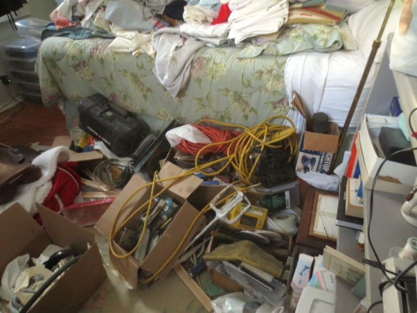 There are items behind the clutter under the bed but difficult to access.