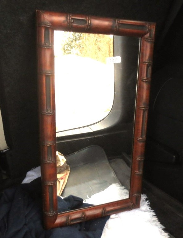"""Bamboo trimmed 10"""" by 18"""" mirror for $18."""
