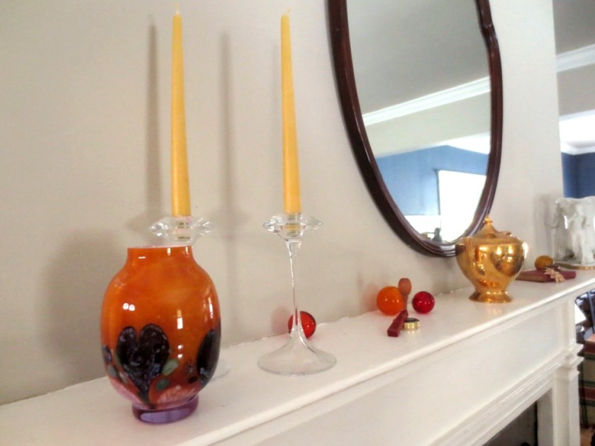A blown glass vase and beeswax candles.