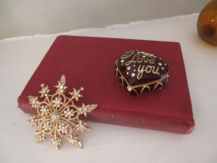 A small red music dictionary with a diamond snowflake and enamel trinket box.