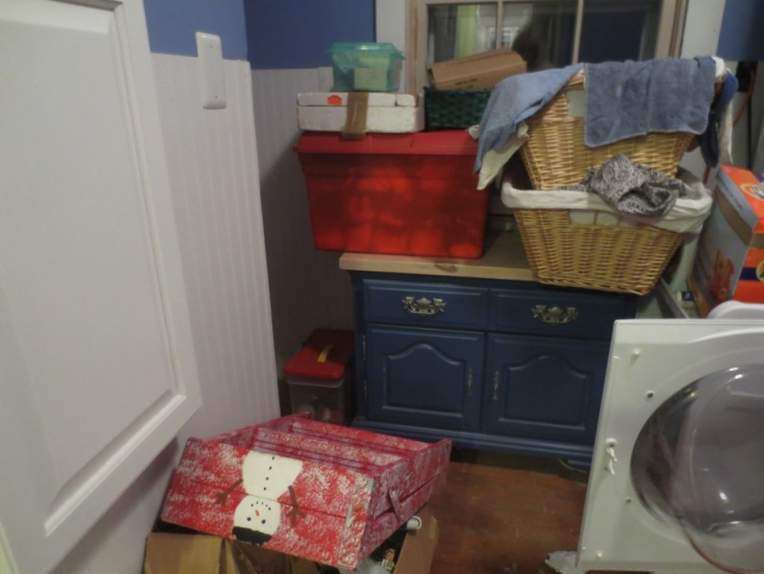 The Christmas stuff makes a stop in the laundry room on its way up to or down from the attic.