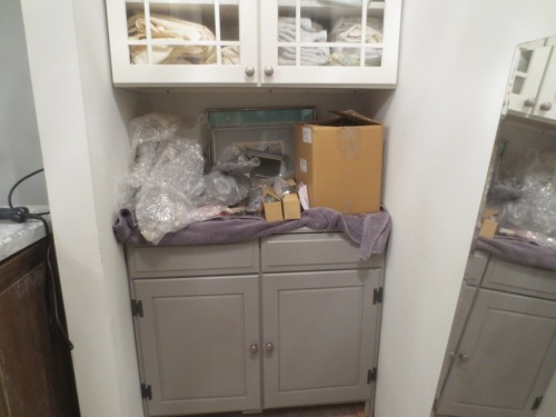 Please ignore the disarray on top of the cabinet -- those are our lighting fixtures and towel bars that still need to be installed in the bathroom.