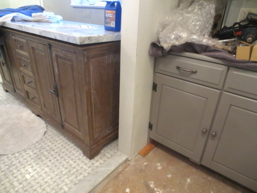 Eventually the vanity will be pushed back out of the doorway.
