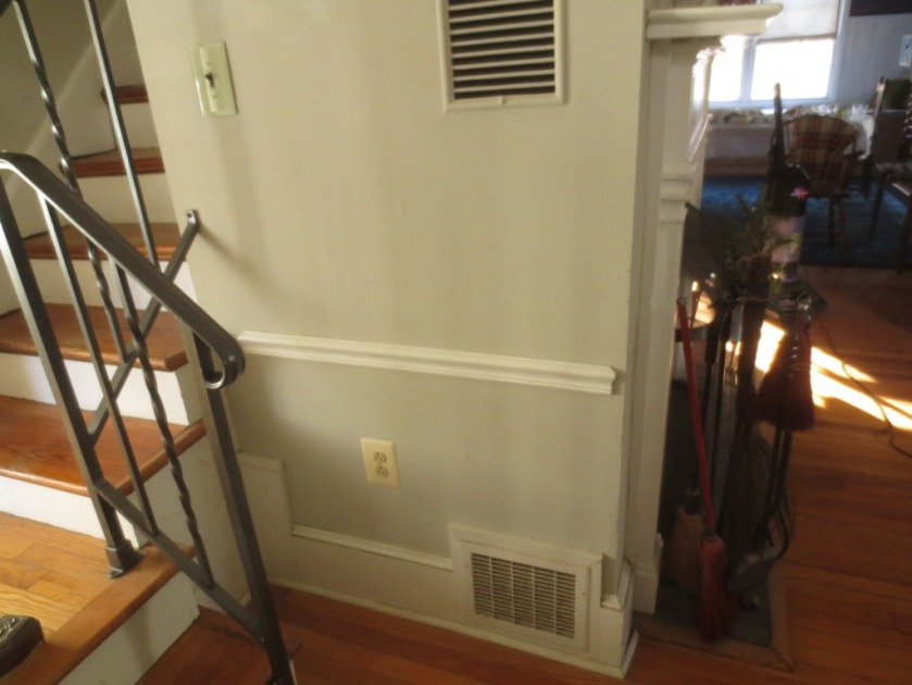 The top grate distributes heat from the fireplace, the bottom grate puts fresh air into the heating system.