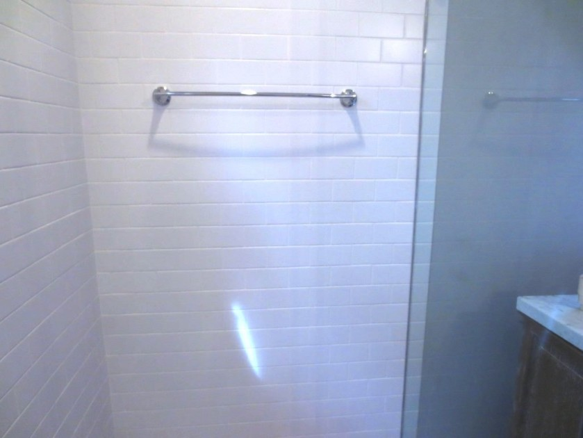 The Moen towel bar inside the shower.