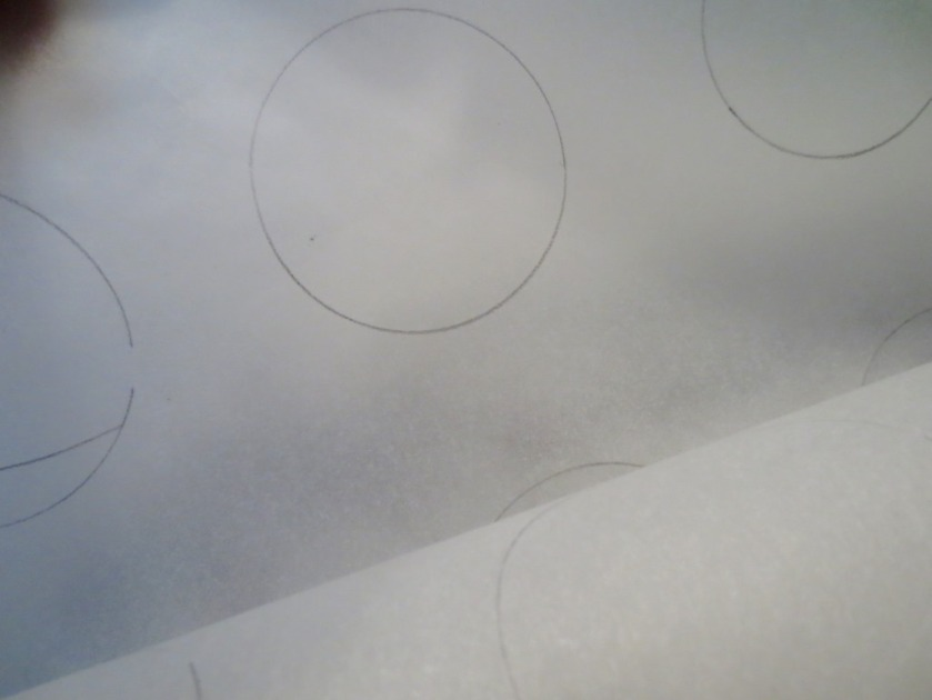 "I drew 2"" circles on parchment with pencil and flipped it -- writing side down -- onto baking sheets."