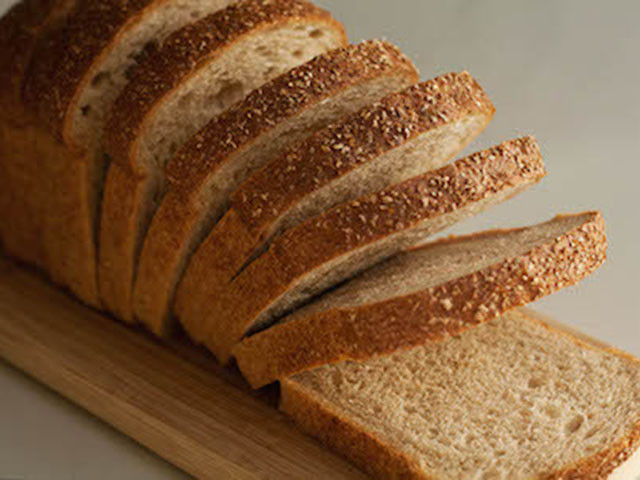 A bakery loaf of honey wheat bread can cost $6.