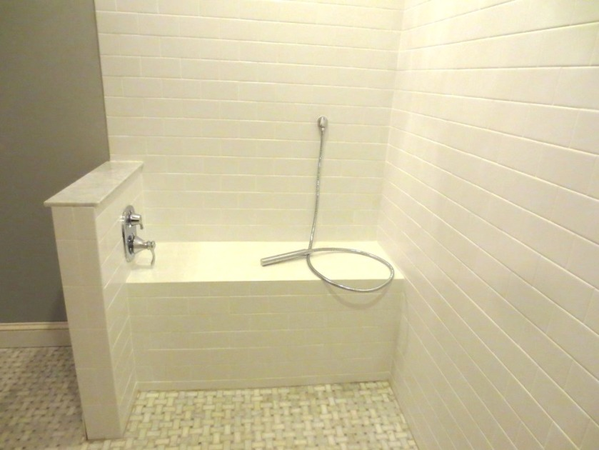 Ice white matte tile is in the shower.