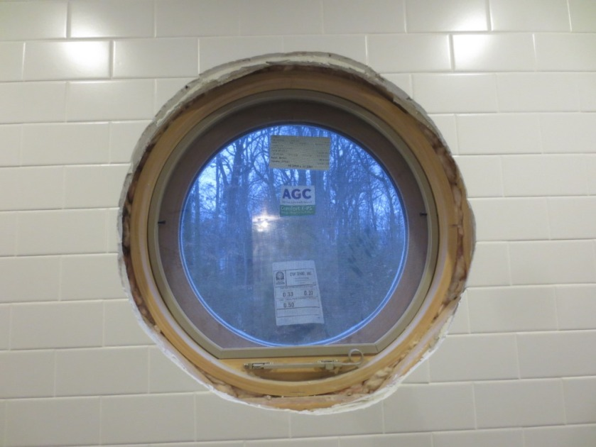 Both new bathrooms have this round window which is inside the shower area.