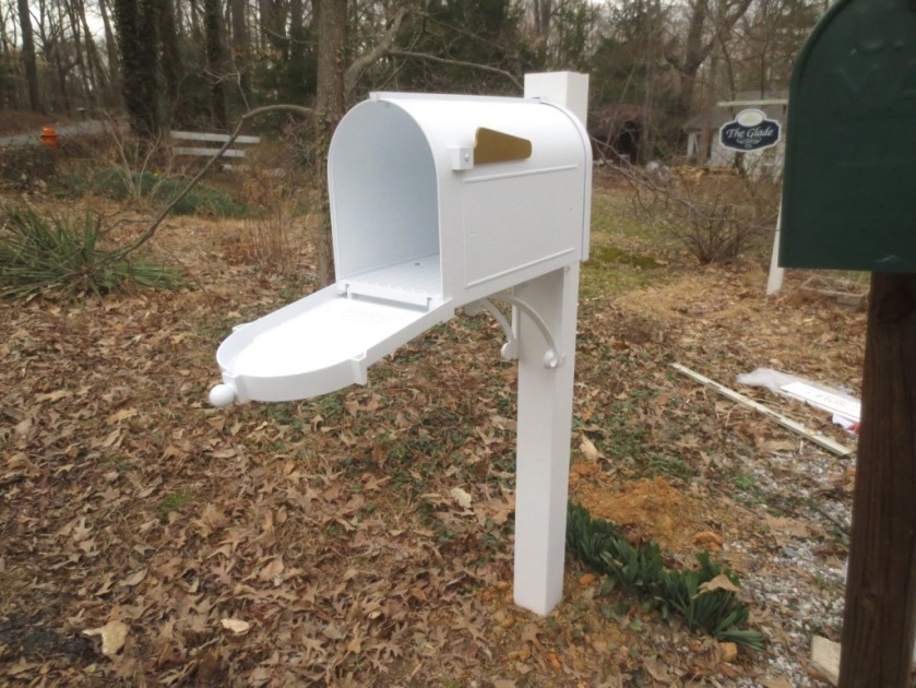 The mailbox is sturdy and heavy and the requisite distant from both the road and the ground (I hope).