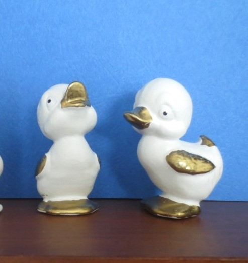 These newly painted white and gold duckies look improved to me.