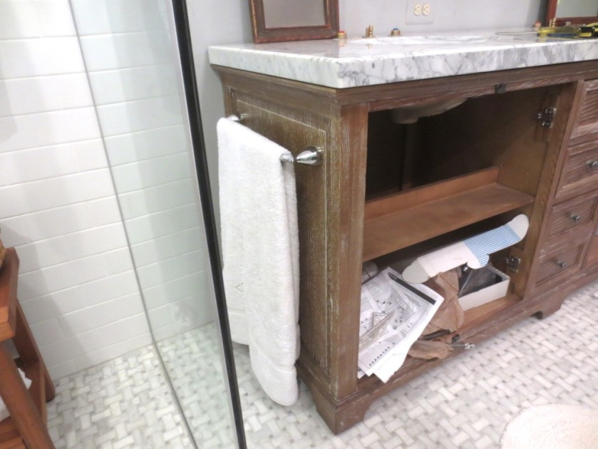 We installed a towel bar on the side of the vanity for Charlie's towel.