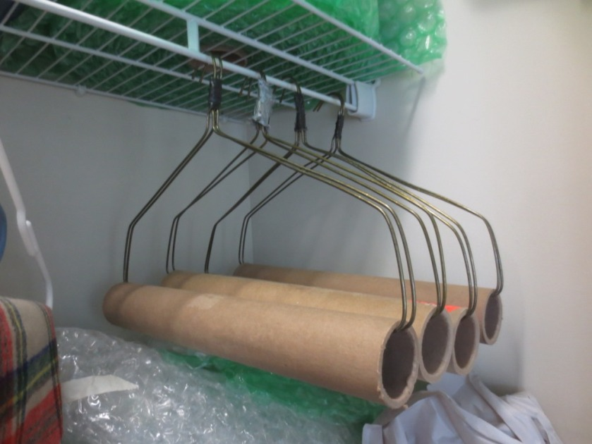 Heavy duty hangers for carrying well-pressed fabric like tablecloths.