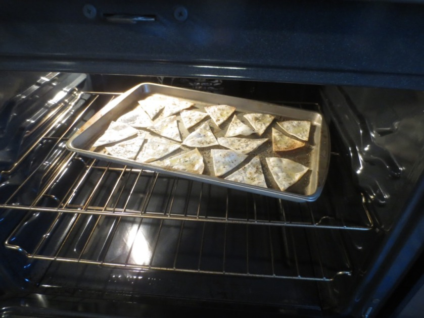 Spread triangles of tortilla on a baking tray and drizzle with olive oil, salt and pepper.