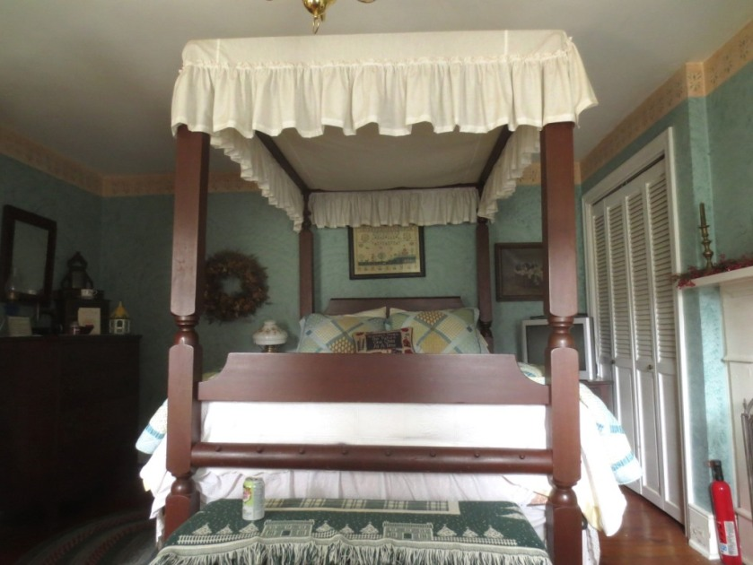 Queen-size canopy bed.