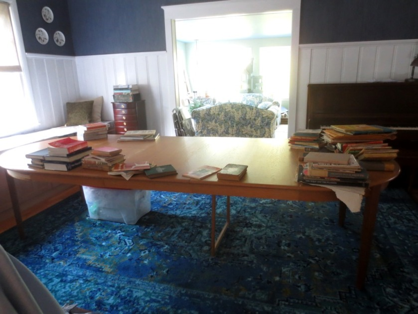 The table now takes up the entire dining room and has lots of rooms for books.