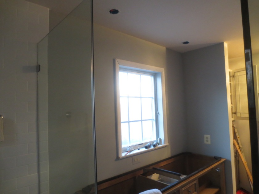 The window wall in the master bathroom needs mirrors.
