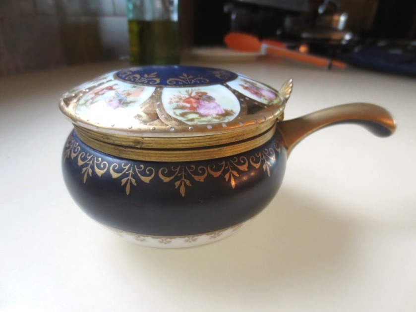 This is a large (4 inch diameter) Limoges hinged-top receptacle.