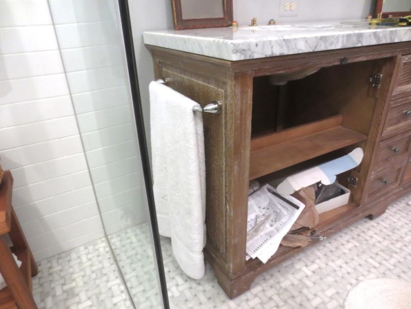 Charlie's towel hangs just outside the shower door.