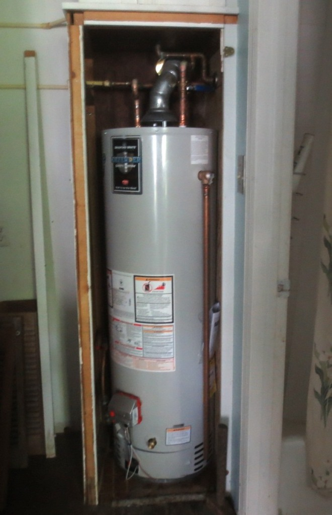 The new water heater is too large to fit in the closet without some adjustment.