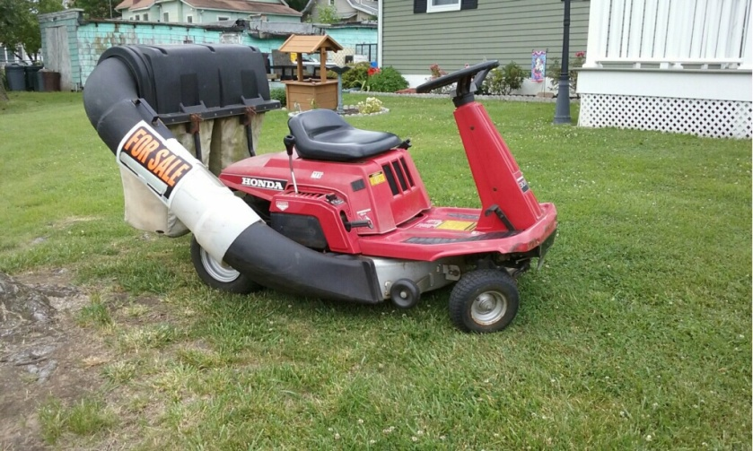 This small Honda mower was for sale in a local front yard.