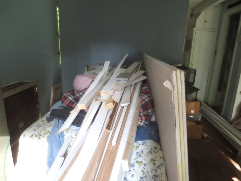 The bed became a dumping ground because it was just inside the door.