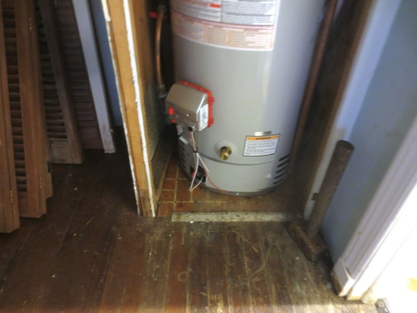 Charlie nudged the left wall out a few inches with the maul (sitting on the floor to the right of the water heater).