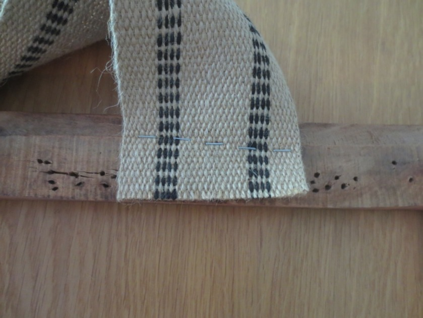The first staples go into the jute webbing held in the opposite direction from its ultimate position.