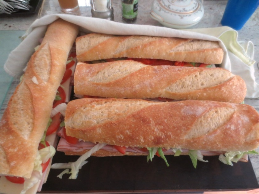Cover the sandwiches with a damp dish towel to keep the sandwiches moist.