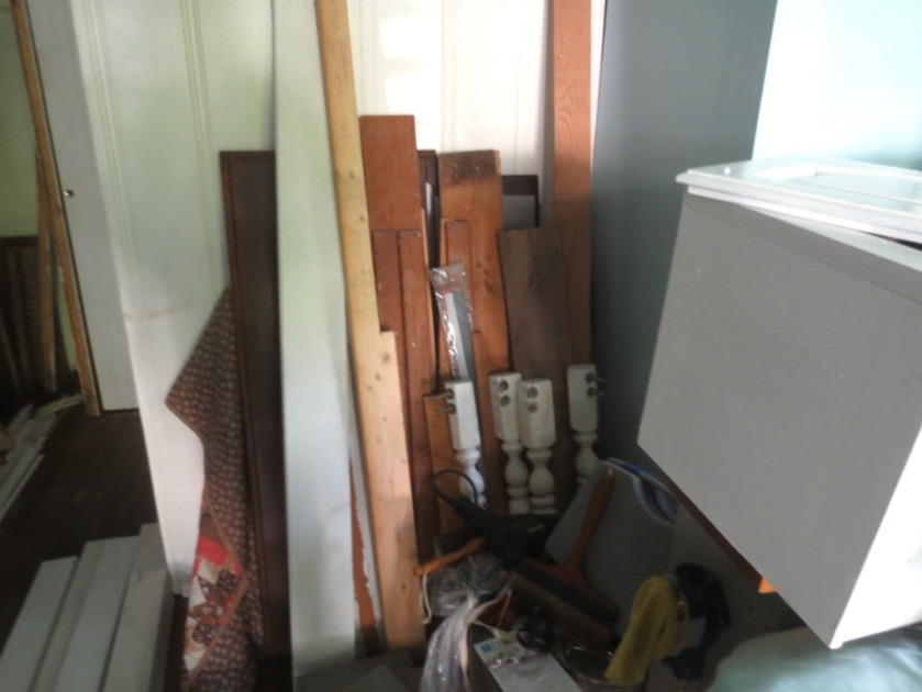 Four white table legs can be seen in the pile of scrap wood in the Cottage.