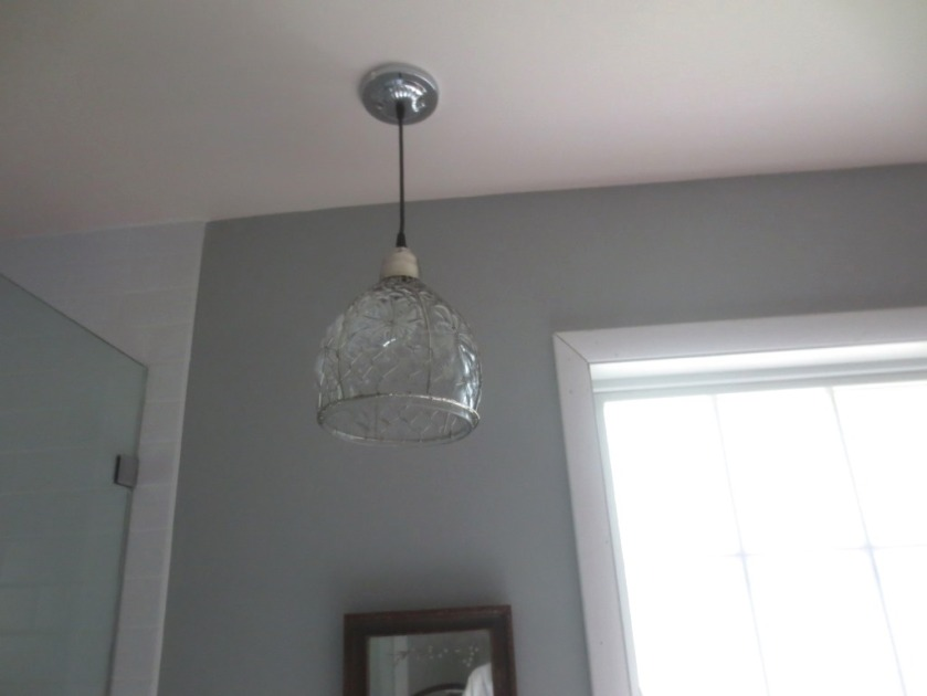 The fixture hangs securely from the ceiling.